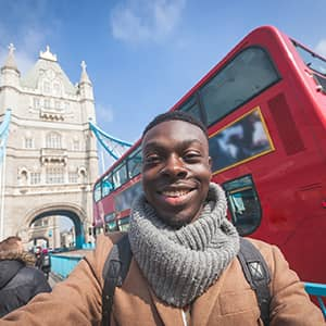 Tourist in front of Tower Bridge, London