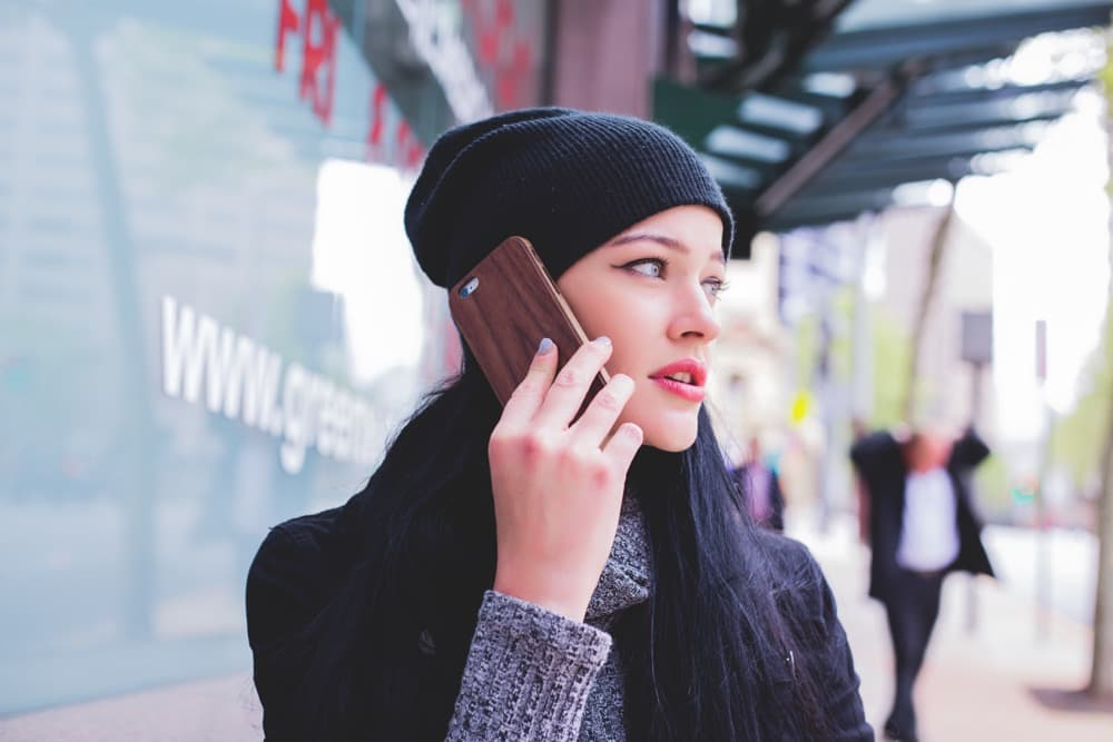 picture of a women calling on her cell phone