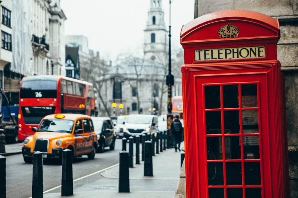 red telephone box and red bus on London street