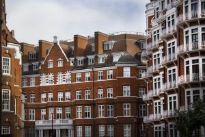 row of red brick houses in london