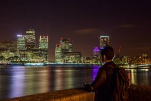 man looking at london at night